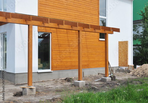 https stock adobe com images contemporary outdoor terrace modern home construction with wooden pillars terrace patio installation 165416904 start checkout 1 content id 165416904