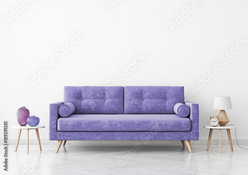 living room interior with violet velvet sofa vases and lamp on empty white wall background