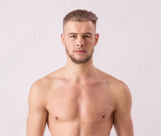 Studio Shot Of Handsome Naked Man Looking To Camera While Standing Isolated On White Background