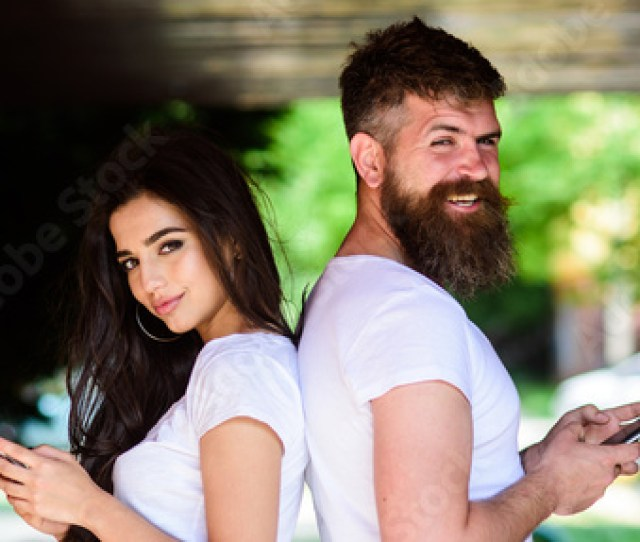 Couple Chatting Smartphones Girl And Bearded Man Stand Back To Back Porch Or Underground