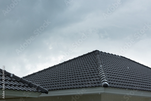 https stock adobe com images rain storm downpour on black roof tile of residential house 255044744 start checkout 1 content id 255044744