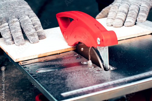 https stock adobe com images cutting floor tiles using tile cutter machine cutting ceramic tiles with electric machine 276880984 start checkout 1 content id 276880984