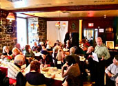President Herb Lewis calls the Annual Luncheon Meeting to order