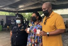 Former president John Mahama and his wife Lordina displaying their COVID-19 vaccination 'passport'