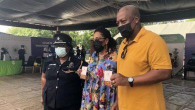 Former president John Mahama and his wife Lordina displaying their COVID-19 vaccination 'passport'