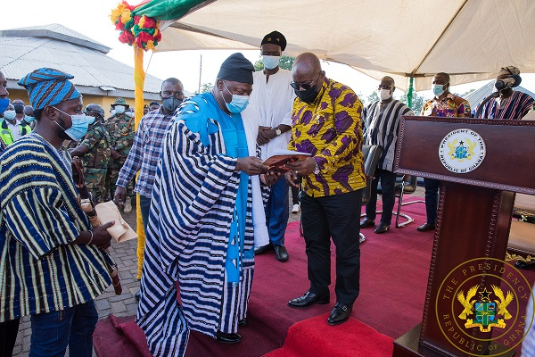 President Akufo-Addo receiving a copy of the document on the Dagbon Development Fund from Alhassan Andani