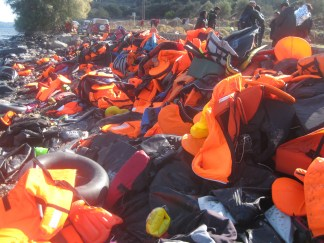 Life jackets piled up for miles along the coast reminding us of just how many people have already passed through.
