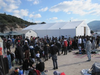 Oxi camp: waiting for bus tickets to registration centres.