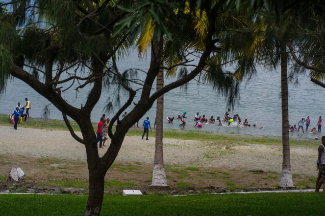a view of people playing in the lake from the porch of Paradise hotel