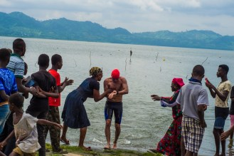 Locals give Martin a hero's welcome after the swim