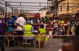 Voters stand by as electoral officials count the ballots. Accra, Ghana