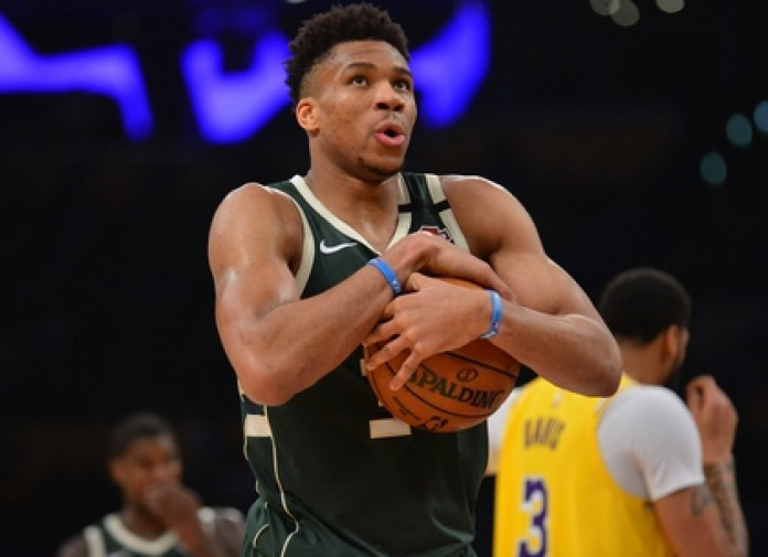 Giannis Antetokounmpo suffered discrimination in Greece, where his family came as an illegal immigrant from Nigeria (Gary A. Vasquez-USA TODAY Sports)