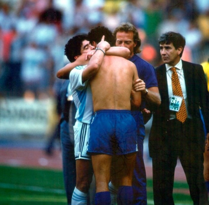 Diego Maradona greets an opponent after the heroic victory against Brazil
