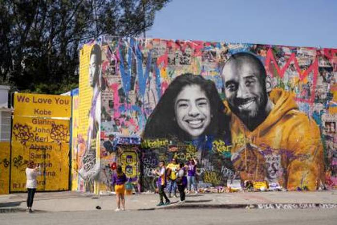 Kobe Bryant with his daughter Gianna immortalized in a Los Angeles building (Reuters)