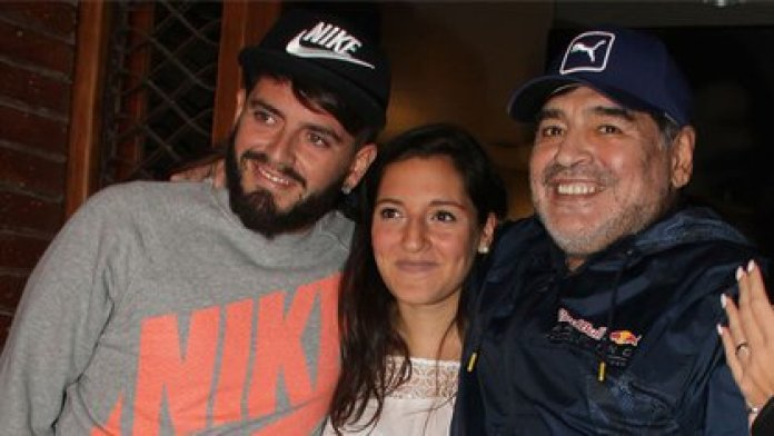 Diego Jr. with one of his sisters, Jana, and his father Diego Maradona