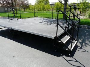 This is a fully assembled 16 X 16 stage with 2 stair unit and railings.