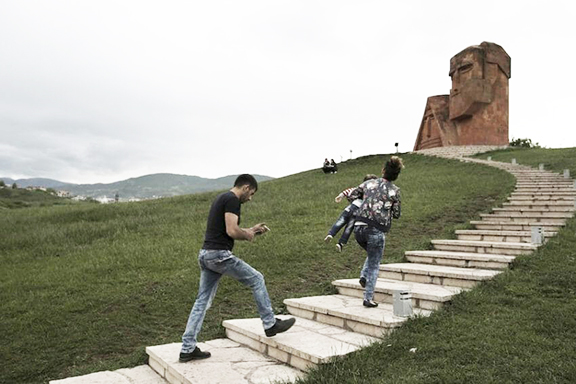 """Visitors climb the stairs to the """"We are Our Mountains"""" monument in Artsakh"""
