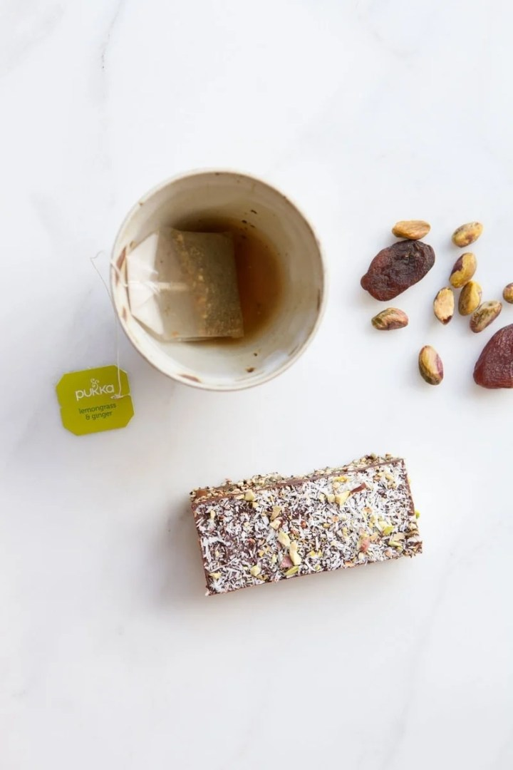 Apricot Chocolate Popped Quinoa Bar and a cup of herbal tea as a healthy afternoon snack