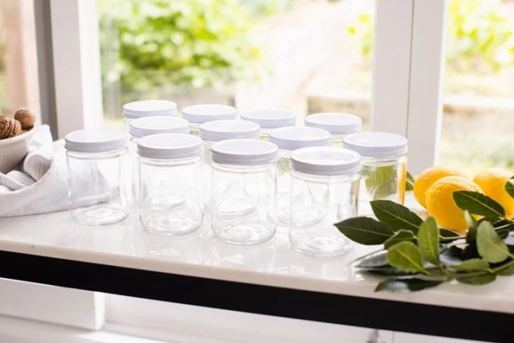 Sterilised canning jars on the table ready to make preserved lemons