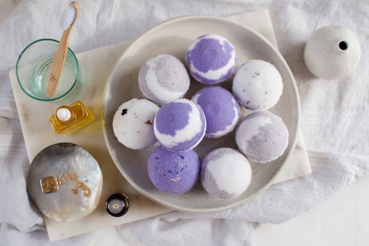 Purple swirled bath bombs presented on a plate