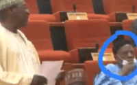 Moment a Nigerian Senator removed his face mask to sneeze during plenary (video) 1