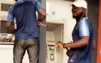 (Video) Coronavirus: Nigerian man Caught on Camera, Operating ATM with a Long stick (video) 2