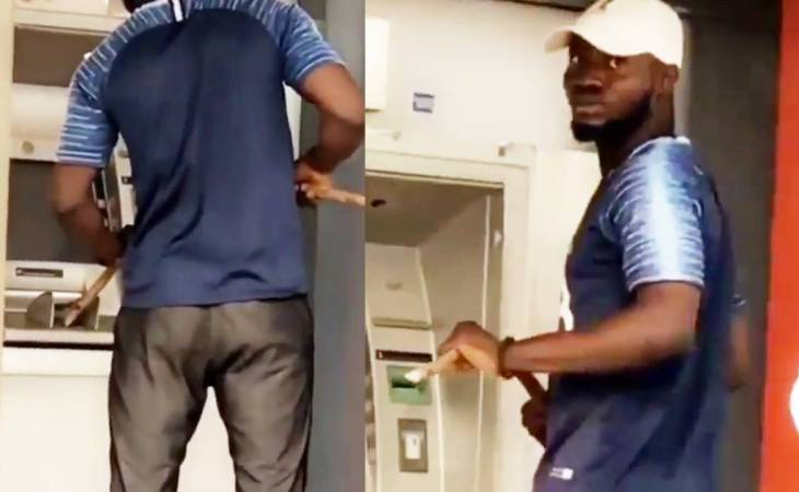 (Video) Coronavirus: Nigerian man Caught on Camera, Operating ATM with a Long stick (video) 1