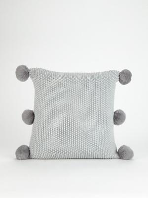 grey knitted pom pom cushion