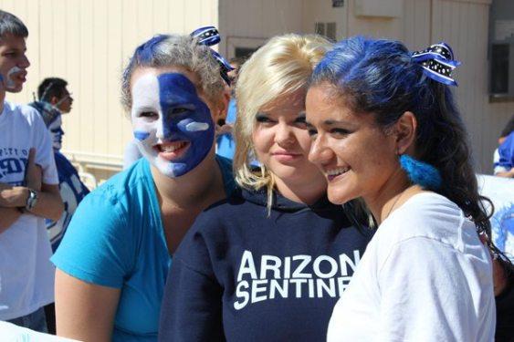 Young Ladies Showing School Pride