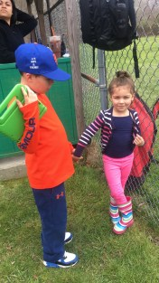 Holding hands with cousin Chloe