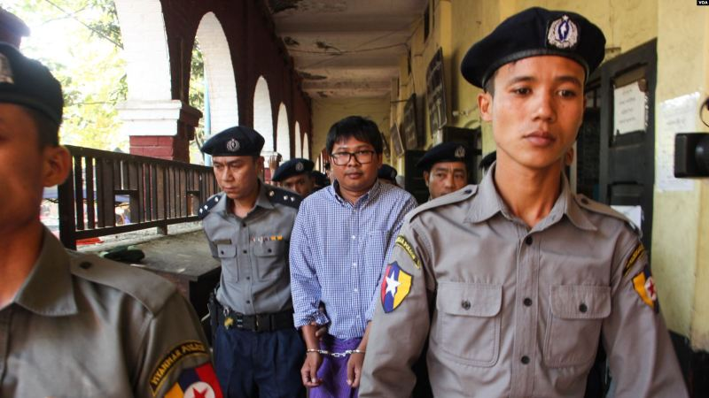 Police_escort_detained_Reuters_journalist_Wa_Lone