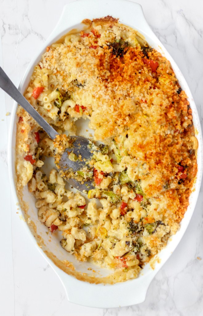 casserole dish of Fontina Baked Macaroni and Cheese with spoon