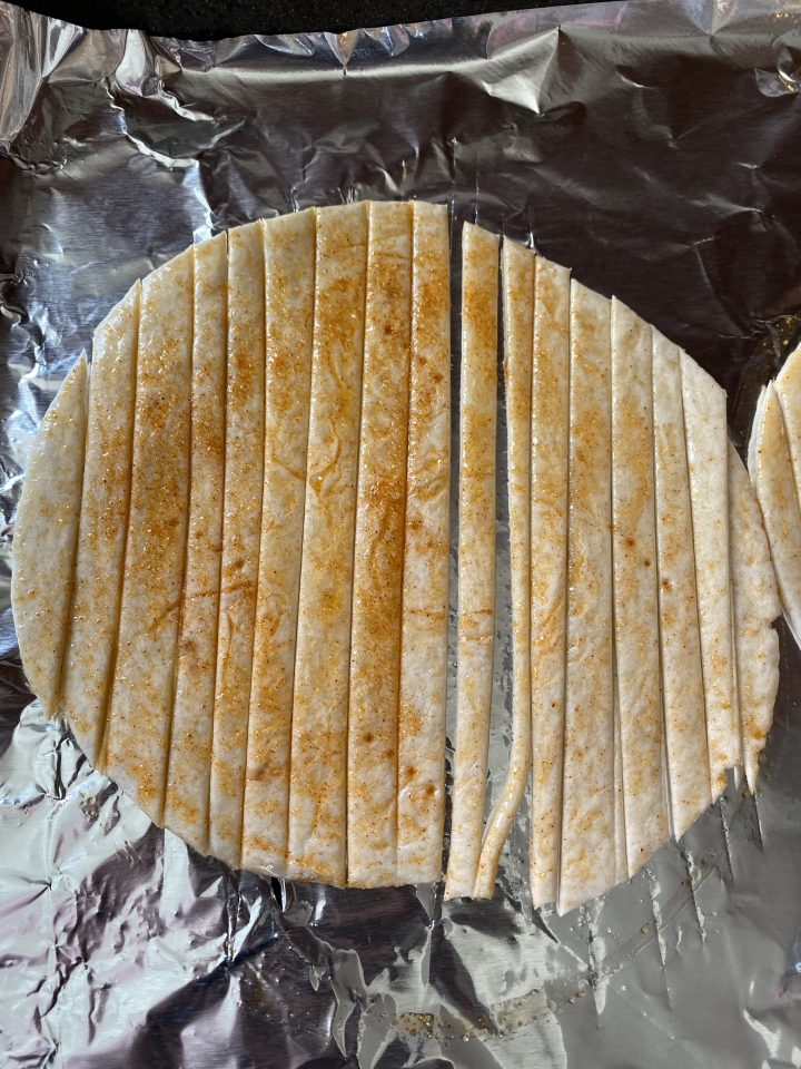 slicing tortilla into strips
