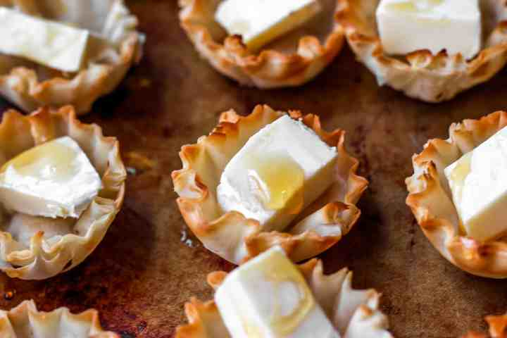 Brie cheese in phyllo cup with honey drizzle
