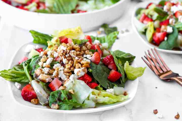 Strawberry spinach salad wit goat cheese and toasted walnuts.