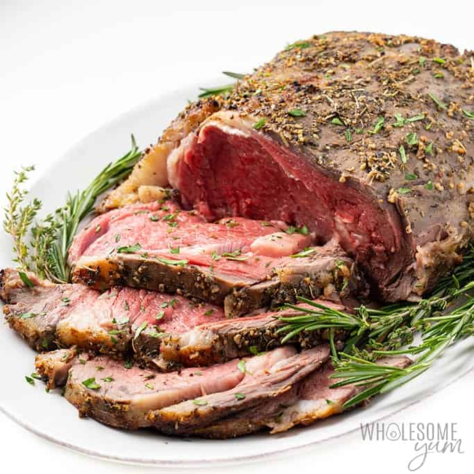 prime rib with rosemary sprigs