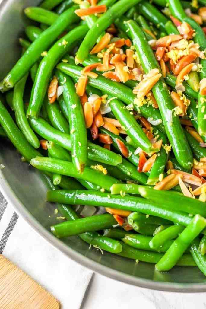 close shot of the green beans with toasted almonds and lemon zest