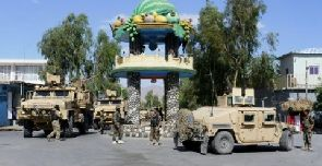 Afghan security forces patrol, after recapturing control of the city from Taliban militants