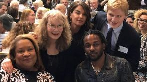 Kendrick Lamar poses for a photo with Mia Farrow and her son