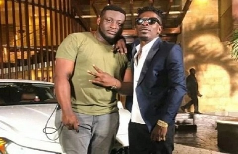 Dancehall artiste, Shatta Wale with his manager, Julio Cyriaano