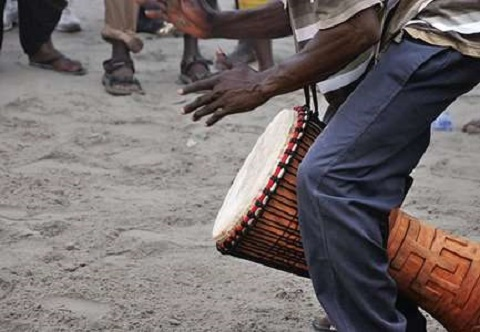 Man plays drum