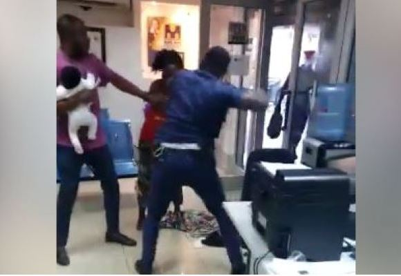 Police man fights lady