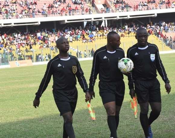 Referee-Sukah-middle-leaving-the-field-at-half-time-of-the-controversial-match
