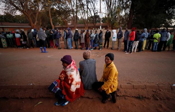 Zimbabwean voters queue to cast their ballots in the country's general elections in Harare