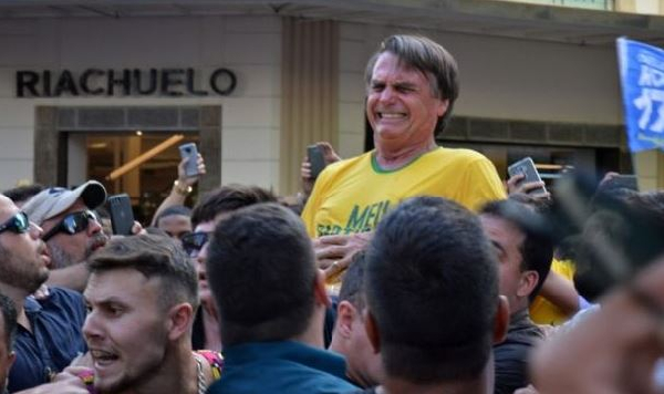 Presidential candidate Jair Bolsonaro pictured after being stabbed in the stomach