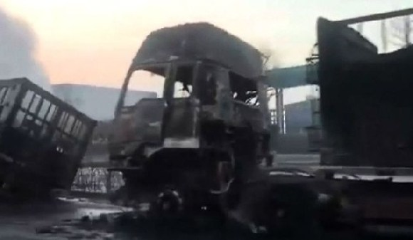 A line of burnt out vehicles could be seen outside the chemical plant