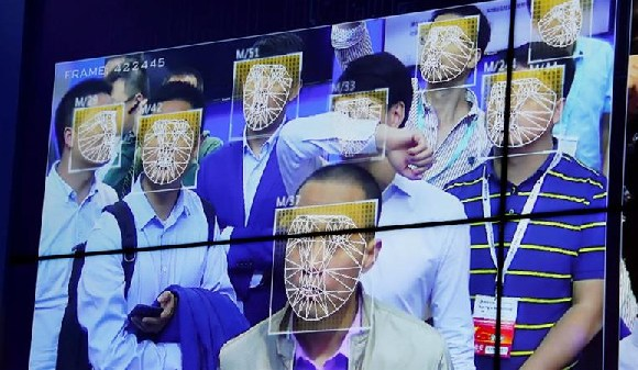 Visitors experience facial recognition technology at the China Public Security Expo in Shenzhen