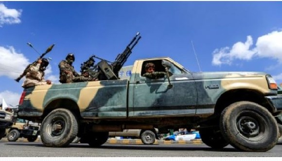 A Yemeni soldier loyal to the Shiite Huthi rebels mans a turret in the back of a pickup truck