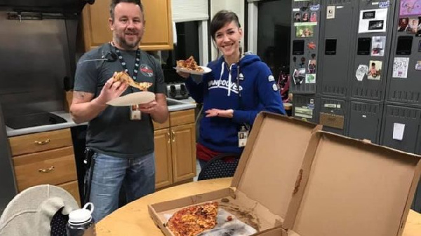 Air traffic control staff in Portland, Maine, with pizza sent in from Moncton, New Brunswick