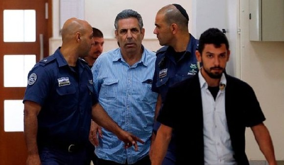 Gonen Segev (centre) reportedly said he had intended to 'fool' Iran with his actions